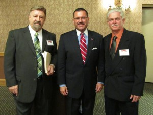 (L-R) AASP/NJ Executive Director Charles Bryant and President Jeff McDowell pose with NJ-MVC Chief Administrator Raymond Martinez (center) at the Association's annual meeting.